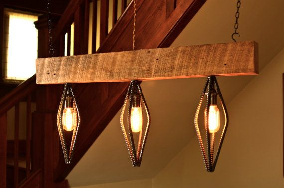 Industrial lighting fixture made from reclaimed barn wood and rebar. Features vintage style Edison bulbs (included) and cloth covered twisted wire. Comes standard with 10 power cable. Light is 33long x 15.5high x 4.5 wide.