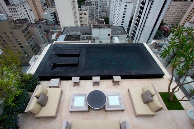 I love this black-tiled roof top pool. Why? Because it's not blue or green or aqua or turquoise, it's black. Imagine on a hot summers day diving into this pool and being cocooned by the cool refreshing water surrounding you. What do you think, are you with me?