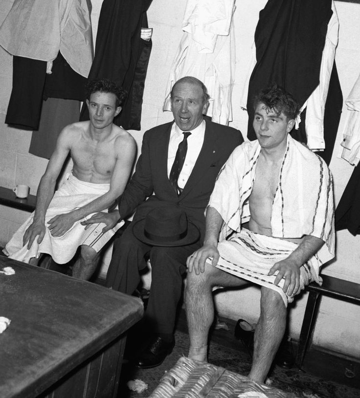 Manchester United manager Matt Busby with two of his players Johnny Berry (left) and Duncan Edwards (right) in the dressing room at Bournemouth after United had qualified for the FA Cup semi final. 2nd March 1957.