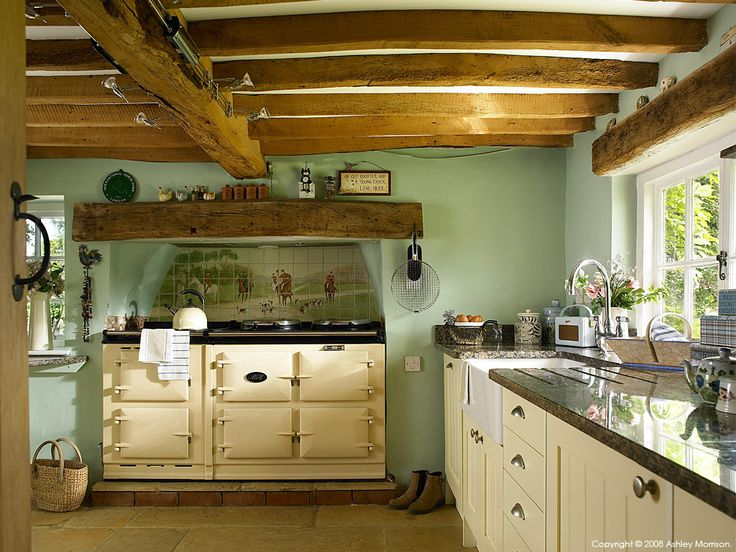 western themed kitchen with old fashioned stove and farmhouse sink