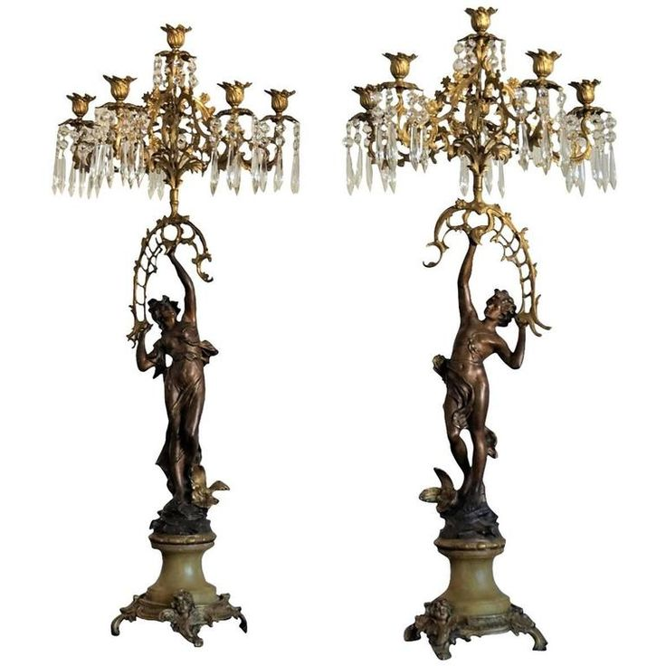19th Century Pair of French Empire Figurine Candelabra Bronze and Gilt Bronze | From a unique collection of antique and modern candle holders at https://www.1stdibs.com/furniture/decorative-objects/candle-holders/