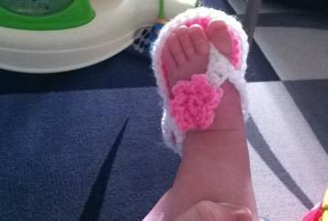 Teeny baby flip flops in action :)