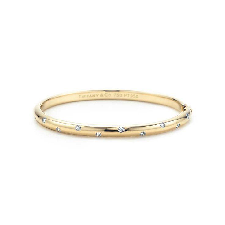 Etoile narrow bangle in 18k gold with diamonds set in platinum, medium.