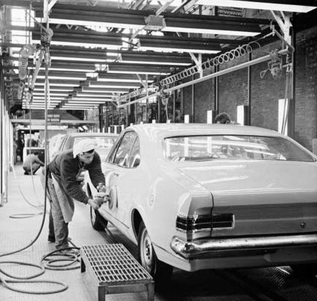 HK Holden Monaro Receiving the Finishing Touches on the  Production Line at the Holden Elizabeth Assembly Plant in South Australia in 1968. This Monaro looks like a Base Model which was available with Three Six Cylinder Options, 161ci 2.65 Litre, 186ci 3.05 Litre and 186s 3.05 Litre.