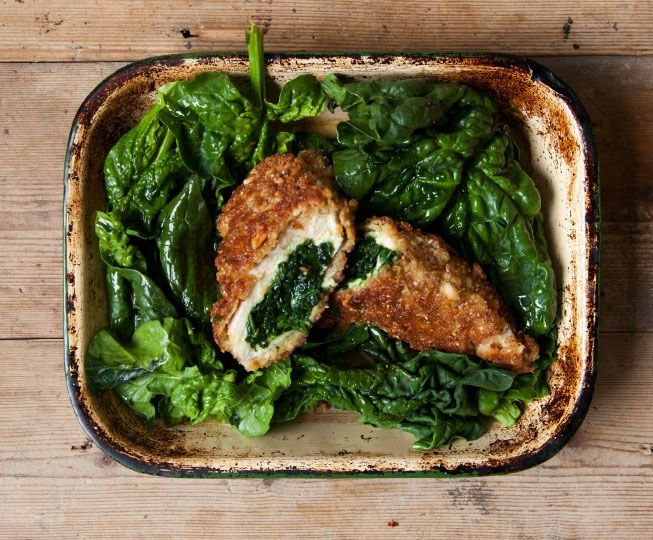 Wild Garlic Chicken Kiev |  You know Spring has sprung when the waft of garlic takes over parks and woodland pathways across the country. Wild garlic has a fresh, chive-like taste with that heady hum of mellow garlic and a mustardy twang. These homemade wild garlic butter stuffed chicken kievs are the ultimate Spring comfort dish and super easy with a few chef's secrets.