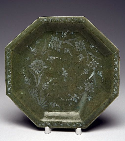 Plate  Iran, Early 18th Century Faience; relief, green glaze, painted in white engobe. Height 18 cm The State Hermitage Museum