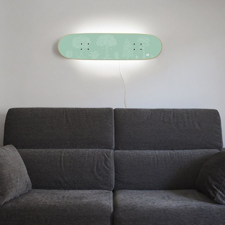 "Skateboard Lamp with a rear mounted LED 7w with white light, provides a nice and soft ambient light suitable for any room of your home. The lamp hang vertically and horizontally. Skate Lamp: skateboarder Children birthday present skateboard Furniture for decoration.  Dimensions: L 31.10"" H 8.07"" The lamp turns on with a switch on the back side."