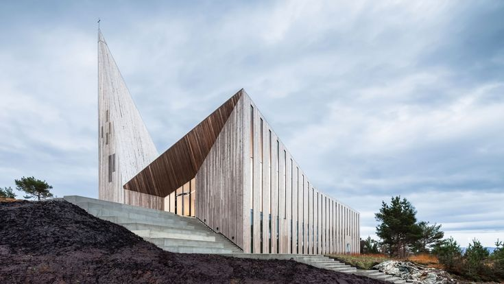 The new church for the village of Knarvik in Hordaland, Norway by the studio of Reiulf Ramstad looks like it has almost been carved out of its craggy surroundings.
