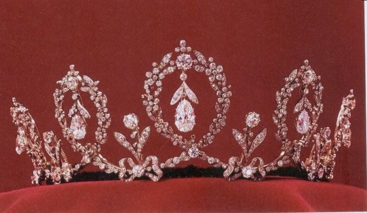 Swedish Crown Jewels - the Connaught Tiara has 5 upright loops of forget-me-not wreaths with a diamond pendant suspended in each. Between the loops, upside down bows support single diamond uprights.  Made by E. Wolff & Co., it was a wedding gift to Princess Margaret of Connaught from her parents, the Duke and Duchess of Connaught, when she married the future King Gustaf VI Adolf of Sweden in 1905.