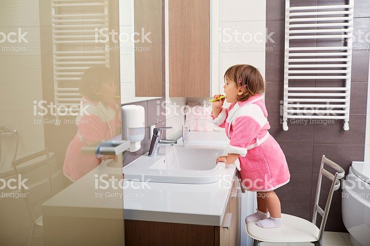 Child cleaning teeth in bathroom. royalty-free stock photo
