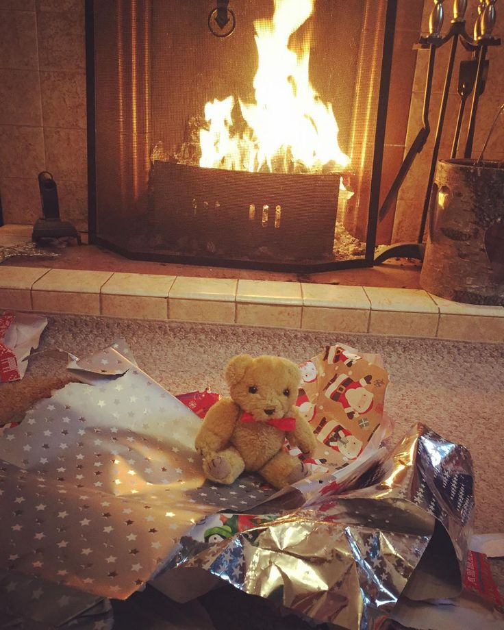 Day twenty five of the 25 days of Christmas photo challenge-I got open presents with my mommy and nanny with a lovely log fire. So Merry Christmas to all my instagram friends  #tt #teddybear #teddy #excited #england #red #yay #yellow #daddy #fun #family #happy #fire #fireplace #love #cute #chill #christmas #christmaspresents #bow #nanny #mom