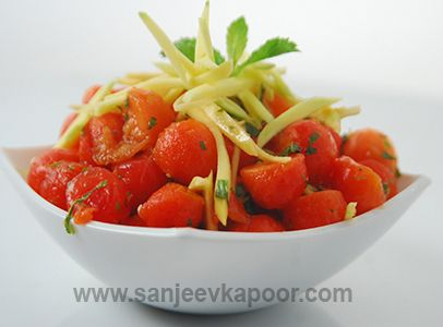 Watermelon and papaya scoops mixed with raw mango strips, green chilli and fresh mint leaves.