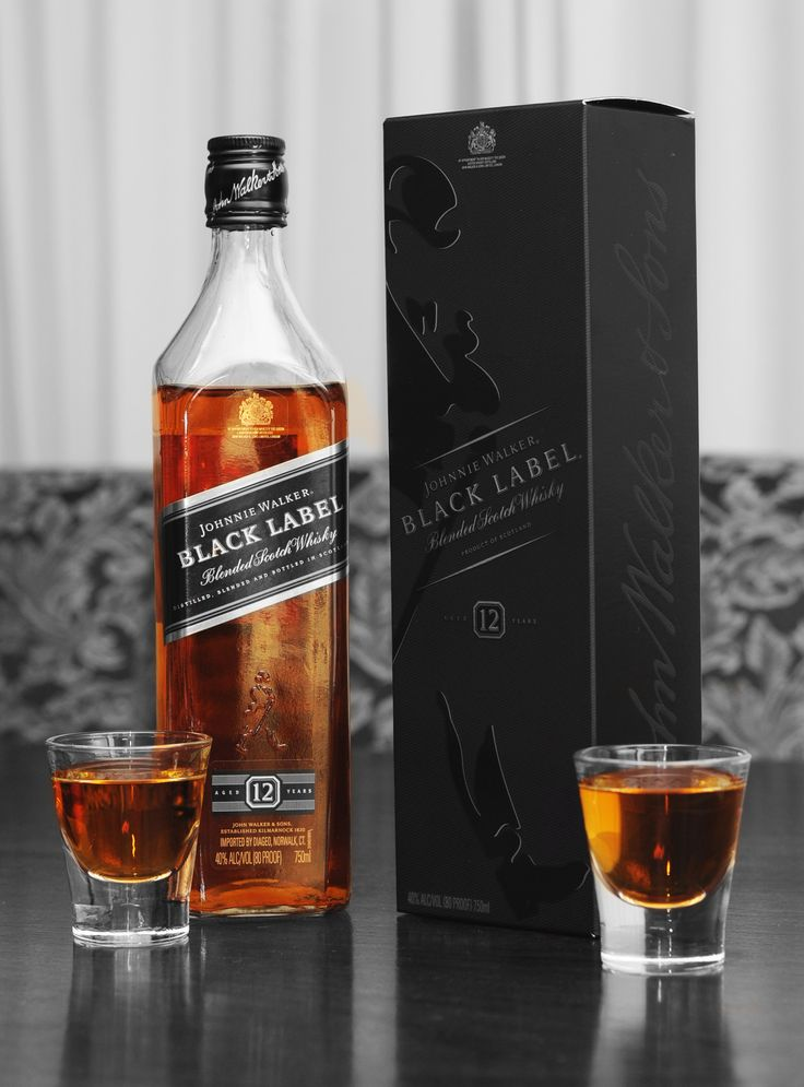 Johnnie Walker: Black Label.  Great blended scotch, although the Red Label is smoother.  Black is more robust and complicated.