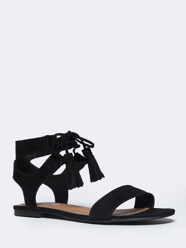A warm weather getaway isn't complete without these ankle tie sandals! -  Features a genuine suede upper with a laced up ankle and cutout back.