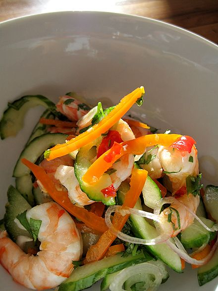 Thai Cucumber and Shrimp Salad - A light, crispy salad with a combination of sweet, sour and spicy to welcome the warm weather. It has shrimp, cucumbers, bell peppers, shallots, chili peppers, Thai basil, and cilantro. The sauce contains lime juice, fish sauce and palm sugar. This salad is great to have as an appetizer or entree. You can substitute the shrimp with shredded chicken, beef or tofu.