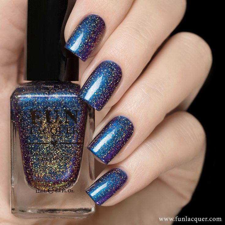 This gorgeous blue and purple holographic nail polish is the epitome of frozen perfection for your nails. Fully opaque in 2-3 coats! Collection: Christmas 2015 Collection