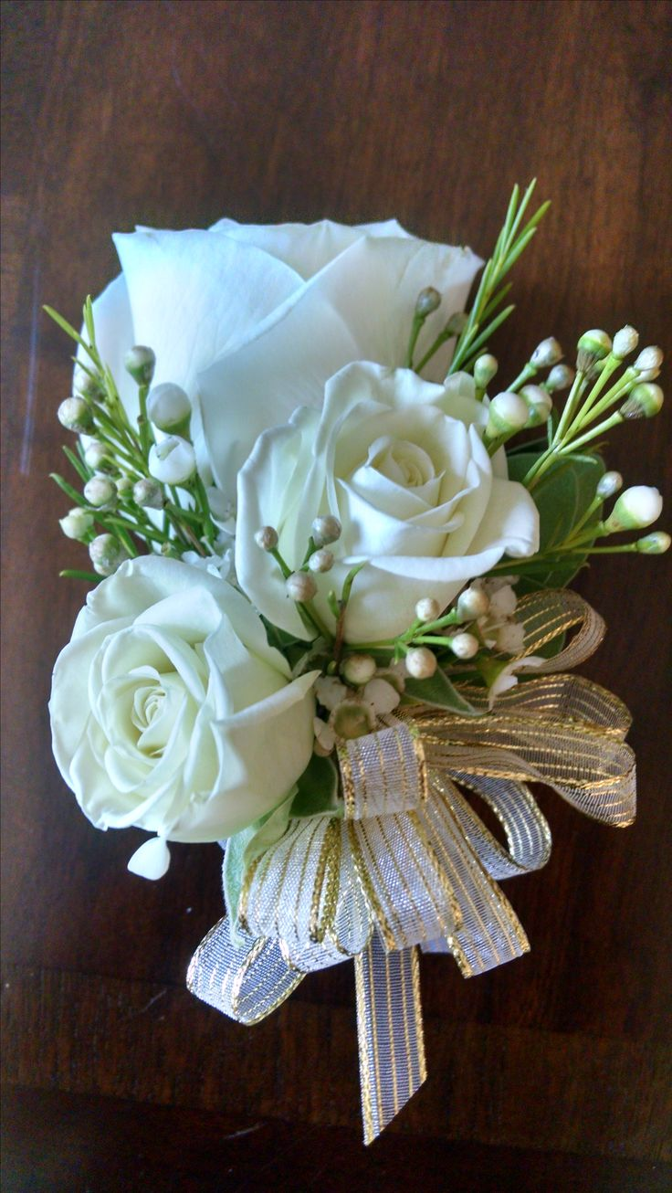Loved it! Pinned it! A Blooming Envy Design! Mother's Corsage  white roses, white wax flowers, gold decorative ribbon.