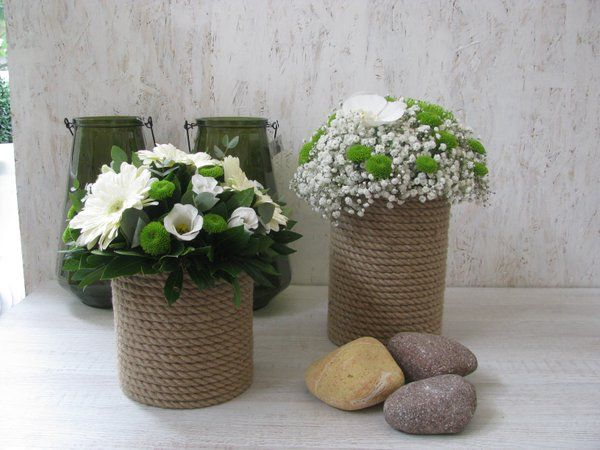 flower arrangements in pots with rope