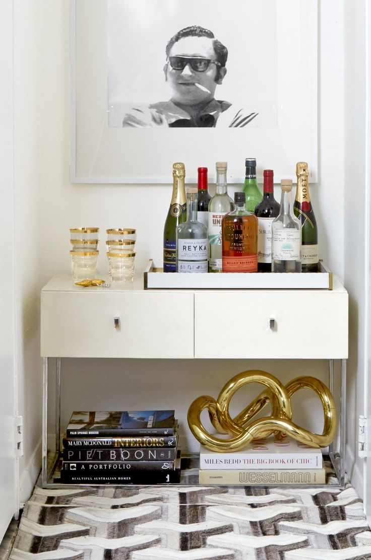 An eye-catching sculpture is still prominently displayed under the small bar cabinet in Nicholas Obeid's apartment.