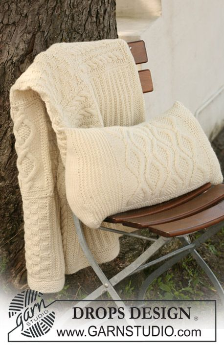 """DROPS 124-2 - Knitted DROPS cushion cover with cables in """"Nepal"""". - Free pattern by DROPS Design"""