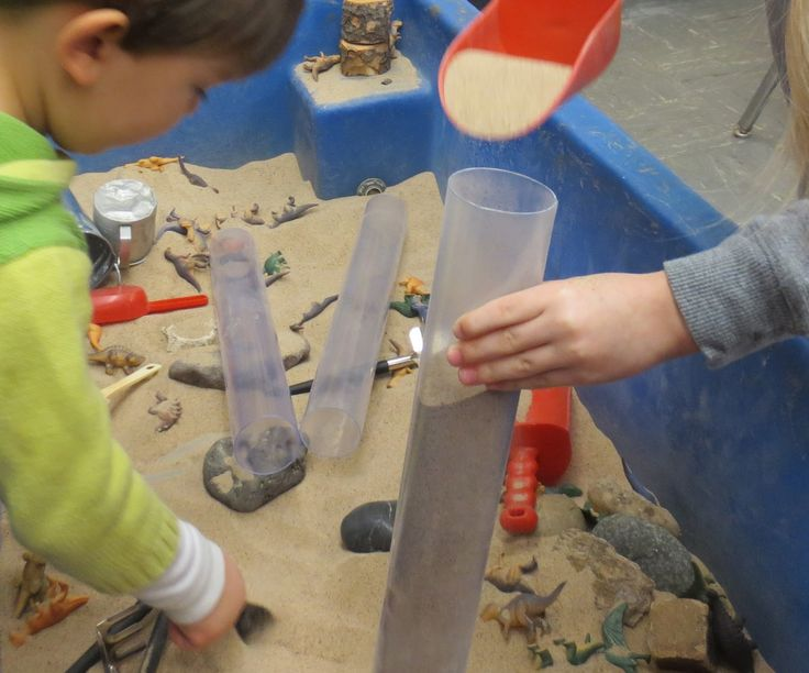 plastic tubes in sensory table (could use paper towel tubes instead)