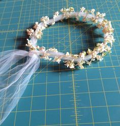 DIY Fairy Headpiece - put flowers round a band and tulle down the back