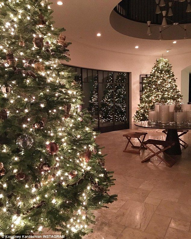 Let the Christmas tree battle begin: Kourtney Kardashian posted this beautiful snap showin...