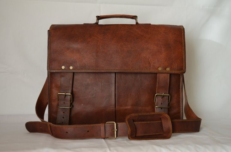 "Traditional design is cleverly crafted of rich leather with custom hardware to help you tote all your tech, news and notes with ease.   Twin Front pocket for I Pad's, notebooks, documents, journals etc, 2 small and 1 big inner compartment for laptops, Macbook , 2 inner and one back zipper.  Size 16"" Length x 12"" height x 5"" Width"