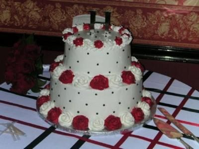 Publix Wedding Cake: Our wedding colors were Red, Black, and White. We decided to go with a wedding cake from Publix Bakery, as the price was only $140!  This style was simple