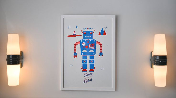 Claudia Urvois Interior Design Children's Bathroom with blue and red robot print and grey ceramic wall lights