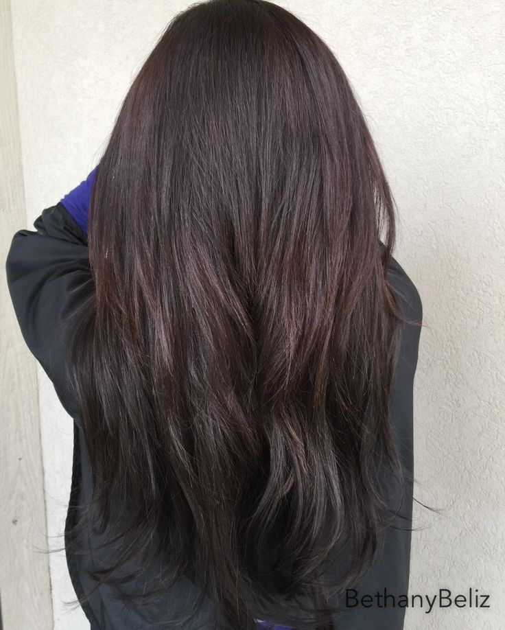 Hotheads tape-in extensions. Long hair. Long layered haircut. 20 inch hair extensions. Silky hair.