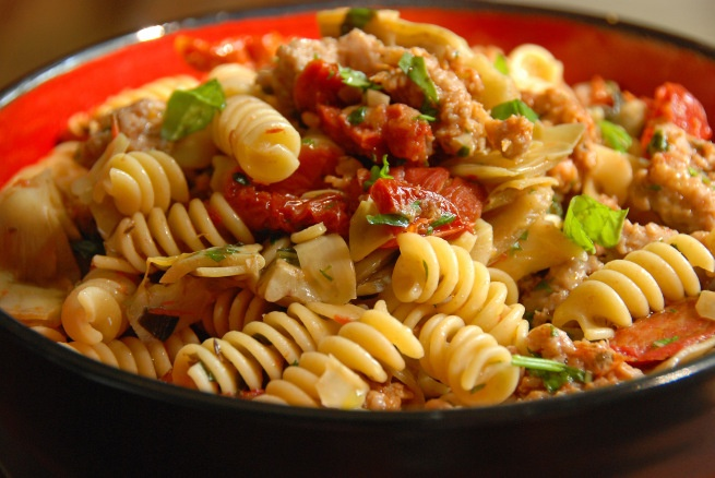 Fusilli with sausage, artichokes and sun-dried tomatoes. This recipe is an adaptation from Giada's original one, so I haven't actually tried this blogger's recipe yet. If you go to this link, Giada's recipe is at the bottom so you can decide for yourself. Giada's is delicious and family-approved! I use gluten-free pasta and venison sausage.