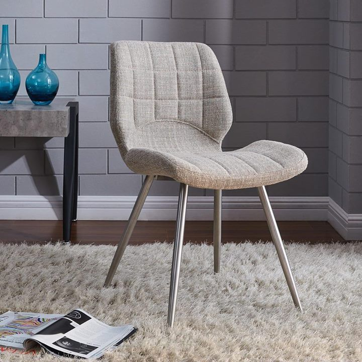 THIS. The Cooper side chair from !nspire will wow you with its design elements…   http://worldwidehomefurnishingsinc.com/cooper-side-chair-in-beige-blend-2pk.html