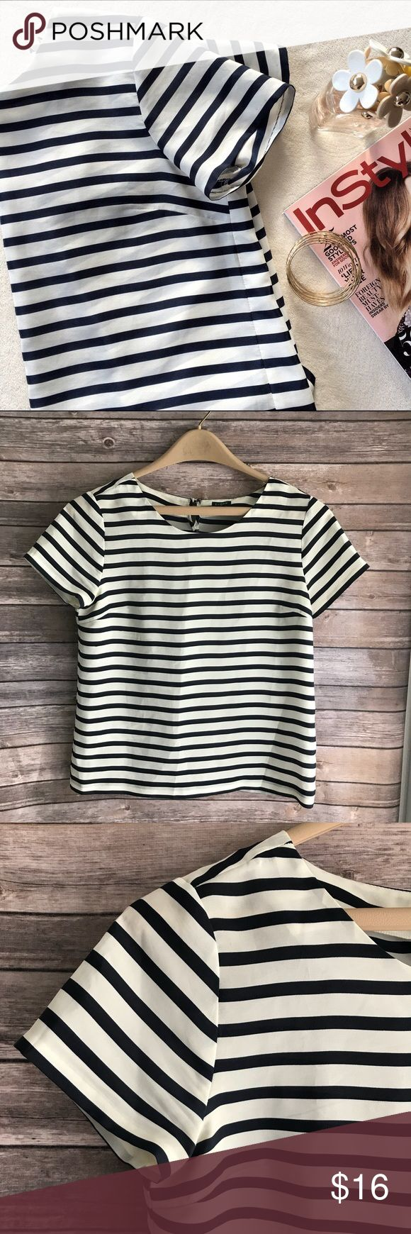 •J. Crew• Navy Striped Nautical Short Sleeve Top Nautical, short sleeve, lightweight J. Crew Striped Top, size small. Super cute design, like new condition. Made of 100% polyester.  Has Button detail on the back of the neck. Cute and can match many outfits. Perfect for layering. J. Crew Tops Blouses