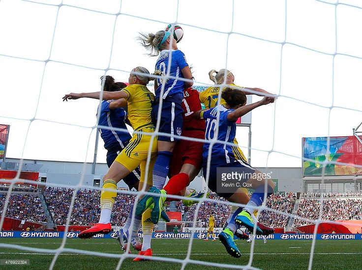 Goalkeeper Hope Solo #1 of the United States jumps with a group to make a save in the first half against Sweden in the FIFA Women's World Cup Canada 2015 match at Winnipeg Stadium on June 12, 2015 in Winnipeg, Canada.