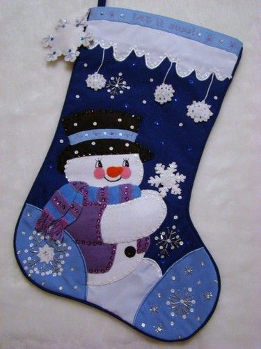 "This wonderful hand~crafted 21"" Christmas Stocking called ""LET IT SNOW""  is made of felt applique on cloth (NOT FELT) and beautifully decorated with hand sewn sequins and beads. Portions of this stocking are stuffed creating a three dimensional apearance. Our stockings measure approx. 21"" diagonally nad 10"" across the top."