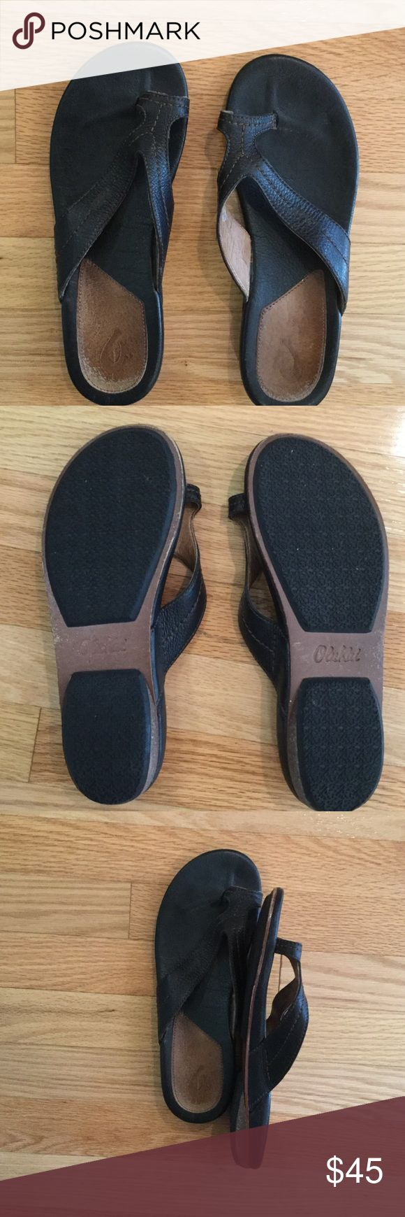 Black leather Olukai sandals with toe loop Sexy sandals, show off your pedicure! Black leather, barely worn. Brown stitching adds interesting detail. OluKai Shoes Sandals
