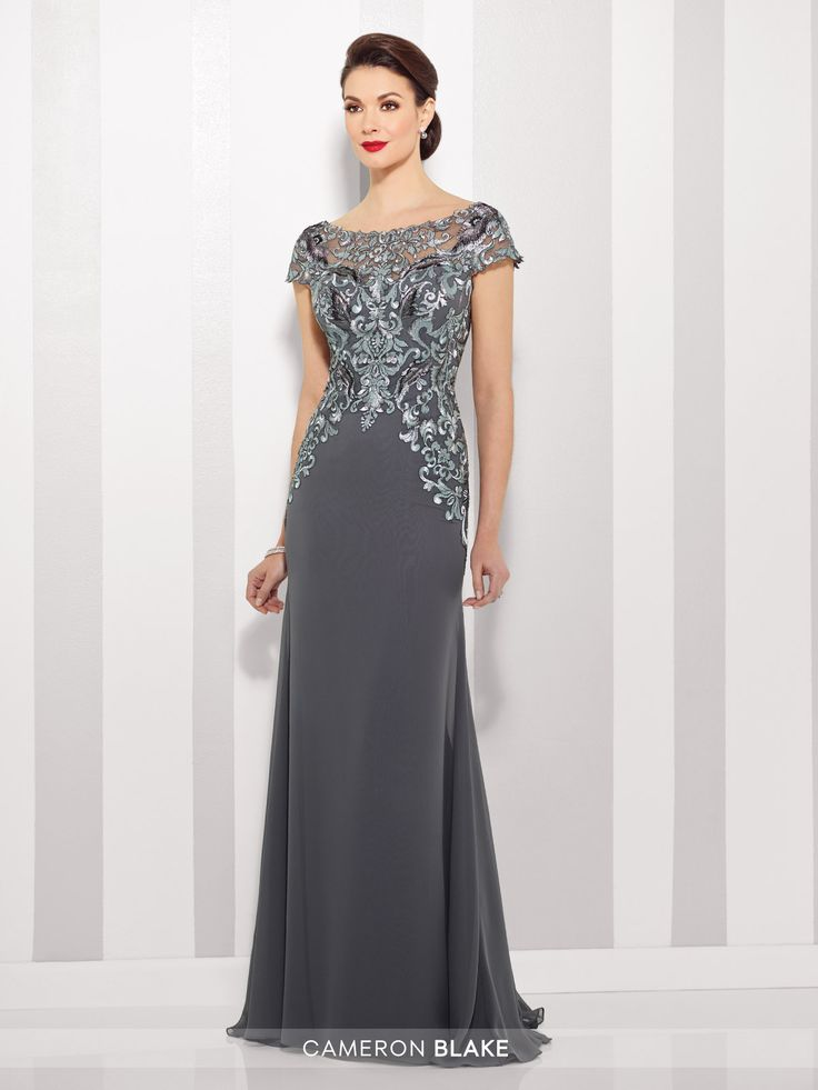 Chiffon slim A-line gown with lace illusion cap sleeve and bateau neckline over a sweetheart bodice, dropped waist, V-back, sweep train.
