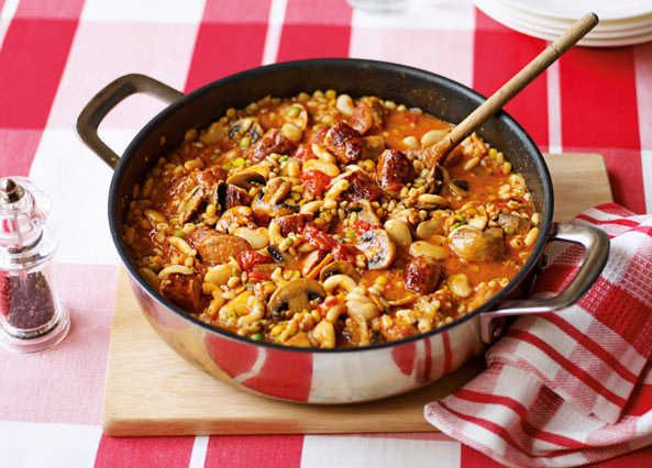 A flavoursome one pot supper with sausages, pulses and tomatoes