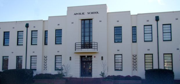 Ainslie School. The building was built in 1938 and is a fine example of the era's Art Deco style, especially in the symmetrical facade, chevron ventilators, front foyer and library mural. It was designed by Cuthbert Whitley.
