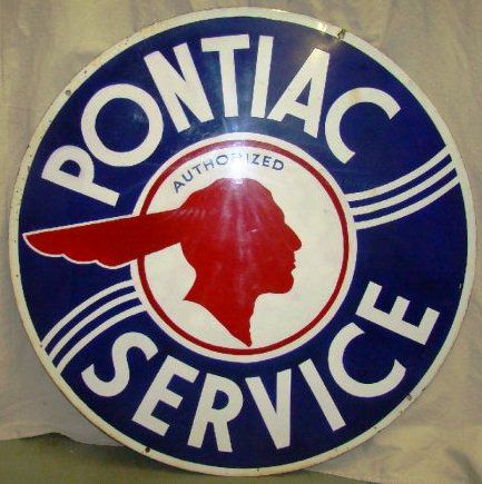 Large round Authorized Service sign for Pontiac showing in the center the old Pontiac symbol.