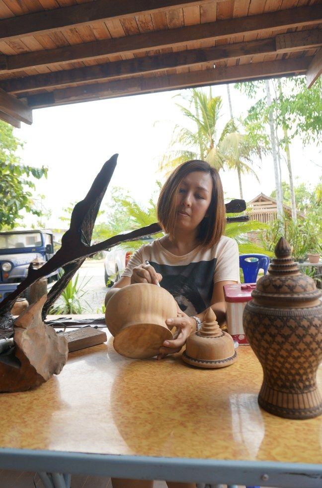 Thailand's best crafts and souvenirs come from the lush tropical forests of Trang Province, known for its aromatic wood and skilled craftsmen. We found gorgeous handbags and trivets