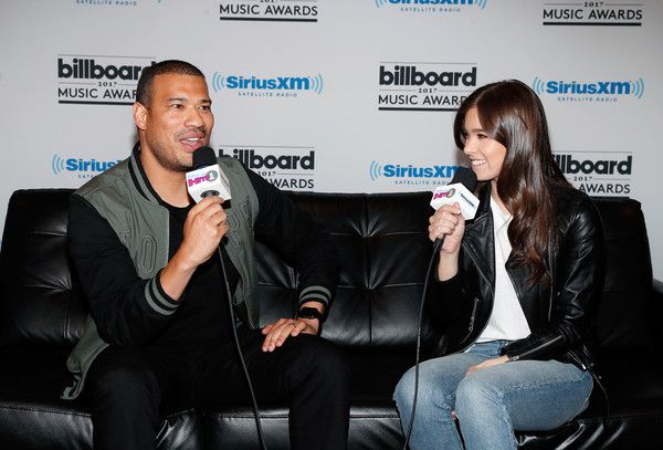 Hailee Steinfeld Photos Photos - Michael Yo (L) interviews Hailee Steinfeld during SiriusXM's 'Hits 1 in Hollywood' broadcast on SiriusXM's SiriusXM Hits 1 channel leading up to the Billboard Music Awards at T-Mobile Arena on May 20, 2017 in Las Vegas, Nevada. - SiriusXM's 'Hits 1 in Hollywood' Broadcasts Backstage Leading Up to the Billboard Music Awards at the T-Mobile Arena