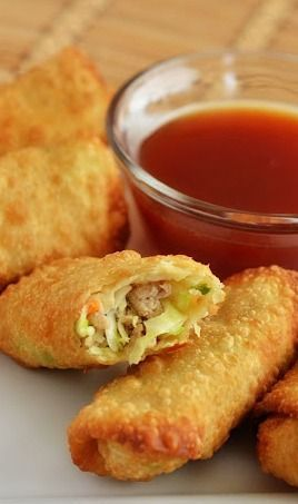 Chicken Egg Rolls 1 pound ground chicken 2 teaspoons fresh minced garlic 1 teaspoon fresh minced ginger 2 cups shredded cabbage 1 cup shredded carrots 1 green onion, thinly sliced 14 egg roll wrappers 2 Tablespoons all-purpose flour 1 Tablespoons water 1 quart Vegetable Oil, for frying
