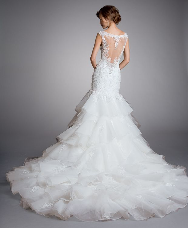 Stunning Eve of Milady bridal gown at StarDust Celebrations - delicately beaded illusion back with cascading train.