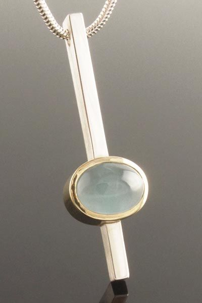 Aquamarine cabochon pendant in silver and 9ct yellow gold ,  Karen Edwards
