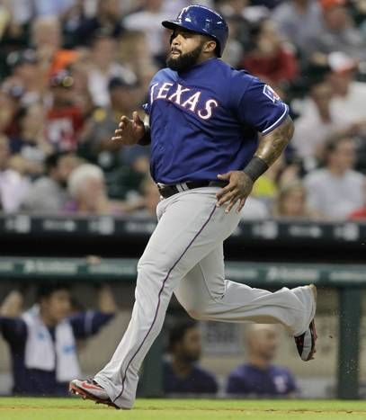 HOUSTON, TX - MAY 06: Prince Fielder #84 of the Texas Rangers scores in the fifth inning on a sacrifice fly ball by Carlos Peguero at Minute Maid Park on May 6, 2015 in Houston, Texas. (Photo by Bob Levey/Getty Images)