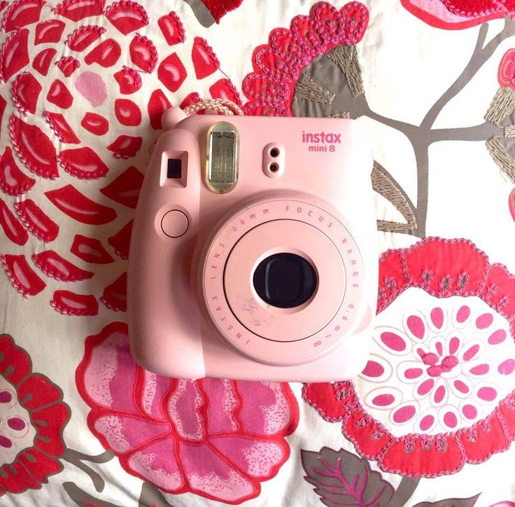 I take my pink Instax mini wherever I go. I love capturing moments, specially while I travel!