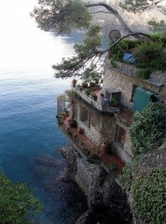 Various sources identify this place as Samos Island, Greece or Cinque Terre, Italy or a piece of digital art fantasy.