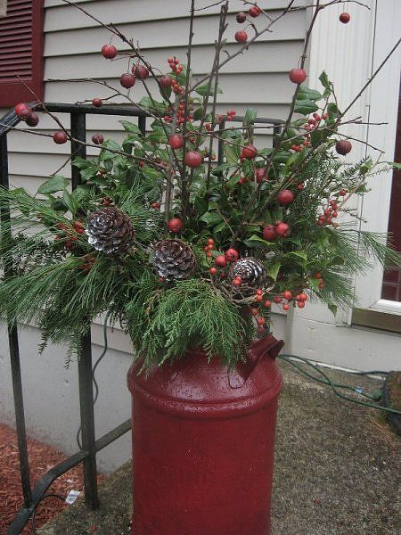 Christmas milk can decor. I would never paint the can though! That would ruin the history and rustic look!